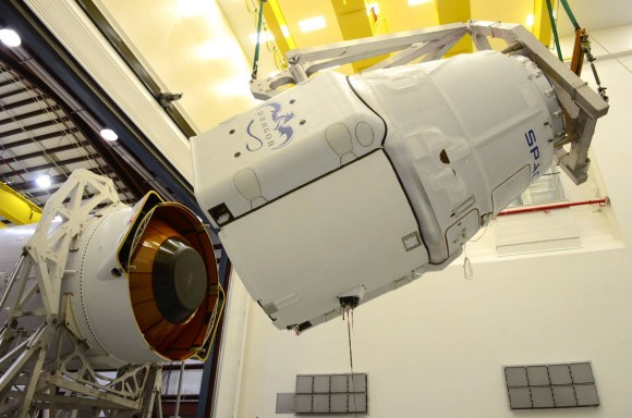 The Dragon spacecraft, filled with about 4,600 lbs of cargo bound for the space station, is mated with Falcon 9.  Credit: SpaceX