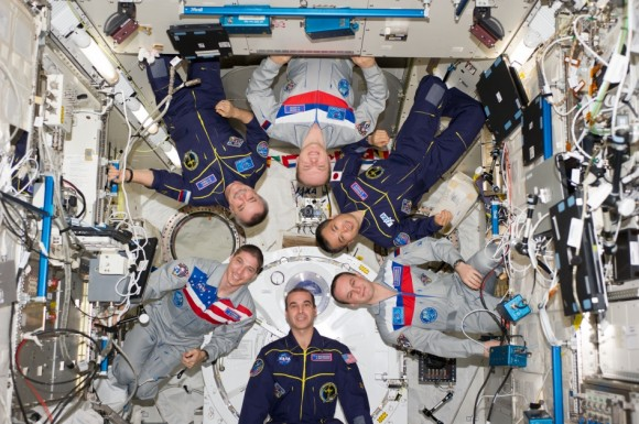 Expedition 38 crew members proudly sport their national flags in this March 2014 picture from the International Space Station. Pictured (clockwise from top center) are Russian cosmonaut Oleg Kotov, commander; Japan Aerospace Exploration Agency astronaut K