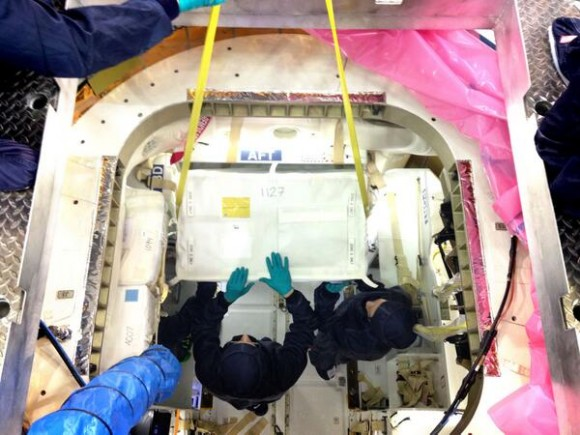 Engineers pack Dragon with cargo, including support for more than 150 science investigations on the ISS. Credit: Spac