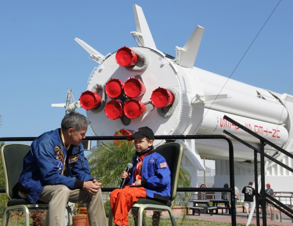 Connor Johnson, 6, talks with former space shuttle commander Bob Cabana, director of Kennedy Space Center, about spaceflight during a ceremony Saturday, March 15, at the Kennedy Space Center Visitor Complex. Johnson, of Denver, Colo., initiated a petition to the White House to maintain NASA funding.  Credit: Ken Kremer - kenkremer.com