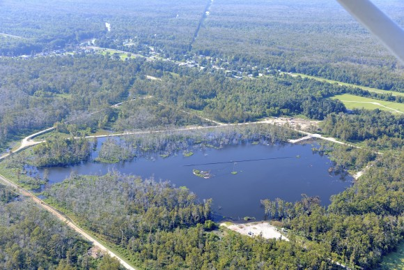 A 25-acre sinkhole near Bayou Corne, Louisiana that formed in Aug. 2012. An analysis of NASA radar data found that the sinkhole was evident in that information before its collapse. Credit: On Wings of Care, New Orleans, La.
