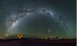 So many stars! A 14-image panorama taken under very dark skies in the heart of the Riverina, New South Wales, Australia, with a bit of direction from a road sign. Credit and copyright: Carlos Orue.