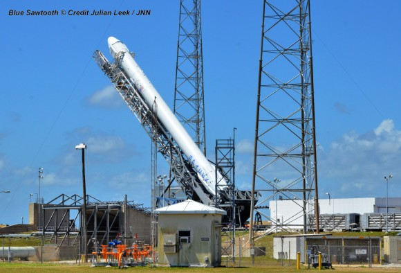 SpaceX Falon 9 rocket preparing for April 14, 2014 liftoff from Space Launch Complex 40 at the Cape Canaveral Air Force Station, Fla.  Credit: Julian Leek