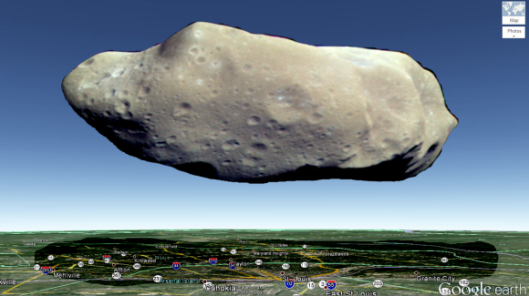 This graphic imagines asteroid 243 Ida as it would fantastically hover over the city of St. Louis, Missouri. Credit and copyright: Ciro Villa.