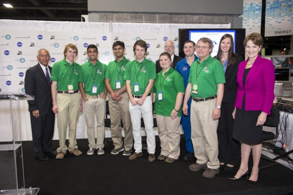 Exploration Design Challenge Winning Team   NASA's Administrator, Charles Bolden (left), President/CEO of Lockheed Martin, Marillyn Hewson (right), and astronaut Rex Walheim (back row) pose for a group photo with the winning high school team in the Exploration Design Challenge. Team ARES from the Governors School for Science and Technology in Hampton, Va. won the challenge with their radiation shield design, which will be built and flown aboard the Orion/EFT-1. The award was announced at the USA Science and Engineering Festival on April 25, 2014 at the Washington Convention Center.  Credit: NASA/Aubrey Gemignani