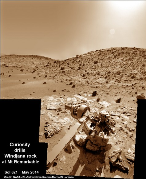 Composite photo mosaic shows deployment of NASA Curiosity rovers robotic arm and two holes after drilling into 'Windjana' sandstone rock on May 5, 2014, Sol 621, at Mount Remarkable as missions third drill target for sample analysis by rover's chemistry labs.  The navcam raw images were stitched together from several Martian days up to Sol 621, May 5, 2014 and colorized.   Credit: NASA/JPL-Caltech/Ken Kremer - kenkremer.com/Marco Di Lorenzo