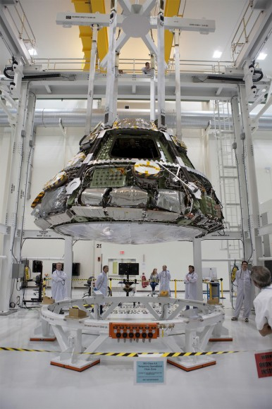 Lockheed Martin and NASA engineers are  installing the largest heat shield ever built onto the Orion spacecraft's crew module at the Kennedy Space Center. Credit: Lockheed Martin