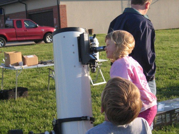Children enjoy a view through a telescope at an astronomy  event in Rochester, Illinois.  Photo by Nancy Atkinson.