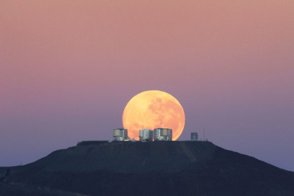The dazzling full moon sets behind the Very Large Telescope in Chile's Atacama Desert in this photo released June 7, 2010 by the European Southern Observatory. The moon appears larger than normal due to an optical illusion of perspective. Image Credit: Gordon Gillet, ESO.
