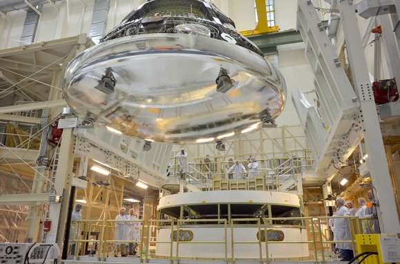 The Orion crew module for Exploration Flight Test-1 is shown in the Final Assembly and System Testing (FAST) Cell, positio