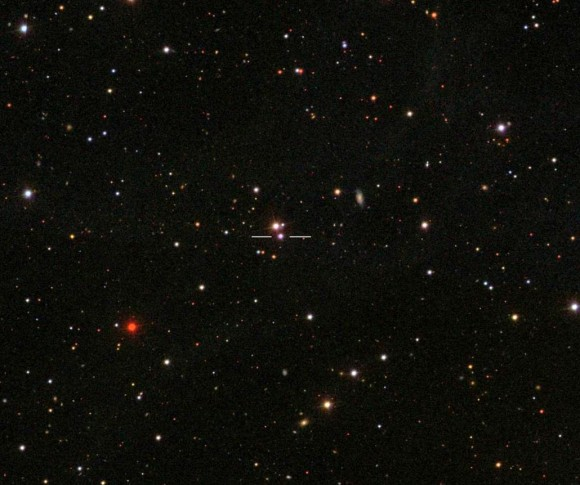 The blazar 3C 454.3 photographed by the Sloan Digital Sky Survey. It's currently in bright outburst and nearly as bright as the star next to it. Both are about magnitude +13.6. Credit: SDSS