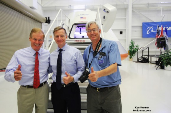 It's 'Thumbs Up' for unveiling of Boeing's CST-100 Space Taxi at NASA's Kennedy Space Center on June 9, 2014.  Florida's US Sen. Bill Nelson (left), final shuttle commander Chris Ferguson (now Director of Boeing's Crew and Mission Operations, center) and Ken Kremer/Universe Today pose in front of capsule with stairway leading to open hatch.  Credit: Ken Kremer - kenkremer.com