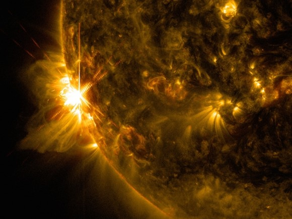A solar flare bursts off the left limb of the sun in this image captured by NASA's Solar Dynamics Observatory on June 10, 2014, at 7:41 a.m. EDT. This is classified as an X2.2 flare, shown in a blend of two wavelengths of light: 171 and 131 angstroms, colorized in gold and red, respectively. Image Credit: NASA/SDO/Goddard/Wiessinger.