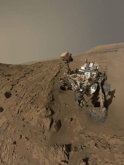 NASA's Mars Curiosity Rover captures a selfie to mark a full Martian year -- 687 Earth days -- spent exploring the Red Planet.  Curiosity Self-Portrait was taken at the  'Windjana' Drilling Site in April and May 2014 using the Mars Hand Lens Imager (MAHLI) camera at the end of the roboic arm.  Credit: NASA/JPL-Caltech/MSSS