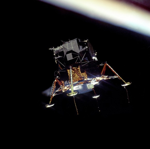 The Eagle Prepares to Land.  The Apollo 11 Lunar Module Eagle, in a landing configuration was photographed in lunar orbit from the Command and Service Module Columbia. Inside the module were Commander Neil