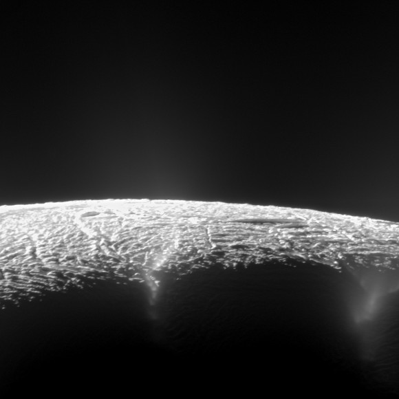 This dramatic view looks across the region of Enceladus' geyser basin and down on the ends of the Baghdad and Damascus fractures that face Saturn. The image, which looks approximately in the direction of Saturn, was taken from a more elevated viewpoint than other Cassini survey images of this area of the moon's south pole.   Credit: NASA/JPL-Caltech/SSI
