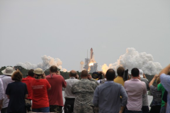 STS-135 Atlantis lifts off on July 8, 2011 with a crowd of people watching the event, the last