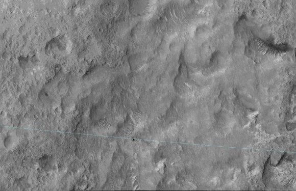 This June 27, 2014, image from the HiRISE camera on NASA's Mars Reconnaissance Orbiter shows NASA's Curiosity Mars rover on the rover's landing-ellipse boundary, which is superimposed on the image. The 12-mile-wide ellipse was mapped as safe terrain for its 2012 landing inside Gale Crater. Image Credit: NASA/JPL-Caltech/Univ. of Arizona