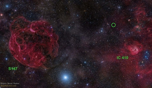 Image of the sky where the radio burst FRB 121102 was found, in the constellation Auriga. You can see its location with a green circle. At left is supernova remnant S147 and at right, a star formation area called IC 410. Credit