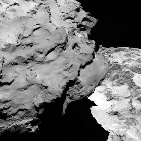 Close-up detail of comet 67P/Churyumov-Gerasimenko. The image was taken by Rosetta's OSIRIS narrow-angle camera and downloaded today, 6 August. The image shows the comet's 'head' at the left of the frame, which is casting shadow onto the 'neck' and 'body' to the right.  The image was taken from a distance of 120 km and the image resolution is 2.2 metres per pixel. Credit: ESA/Rosetta/MPS for OSIRIS Team MPS/UPD/LAM/IAA/SSO/INTA/UPM/DASP/IDA