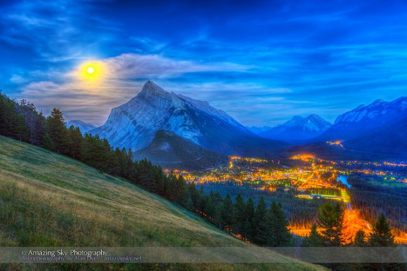 The supermoon of August 10, 2014 rising behind Mt. Rundle and Banff, Alberta, Canada as shot from the Mt. Norquay viewpoint looking south over the valley. Credit and copyright: Alan Dyer.