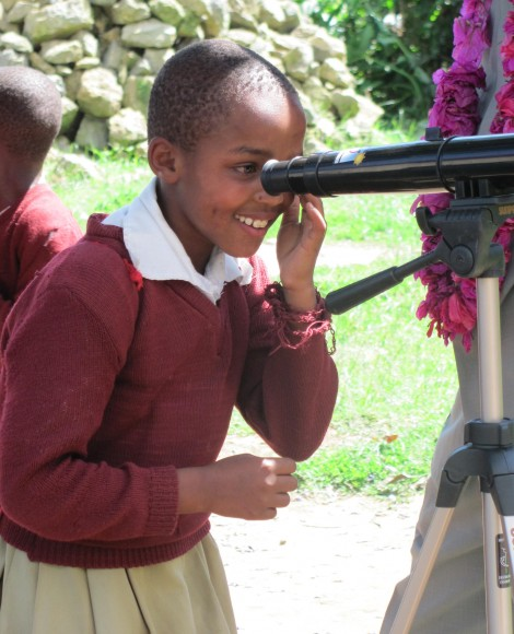 A student uses a telescope for the first time at Kalinga Primary School in northern Tanzania. Credit: Telescopes to Tanzania/Indiegogo