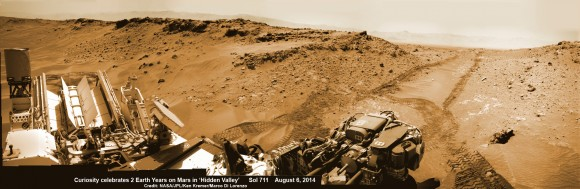 2 Earth Years on Mars!  NASA's Curiosity rover celebrated the 2nd anniversary on Mars at 'Hidden Valley' as shown in this photo mosaic view captured on Aug. 6, 2014, Sol 711.  Note the valley walls, rover tracks and distant crater rim. Navcam camera raw images stitched and colorized.  Credit: NASA/JPL-Caltech/Ken Kremer-kenkremer.com/