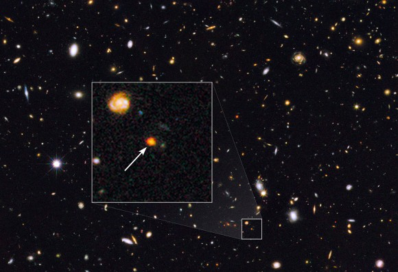 This image shows observations of a newly discovered galaxy core dubbed GOODS-N-774, taken by the NASA/ESA Hubble Space Telescope's Wide Field Camera 3 and Advanced Camera for Surveys. The core is marked
