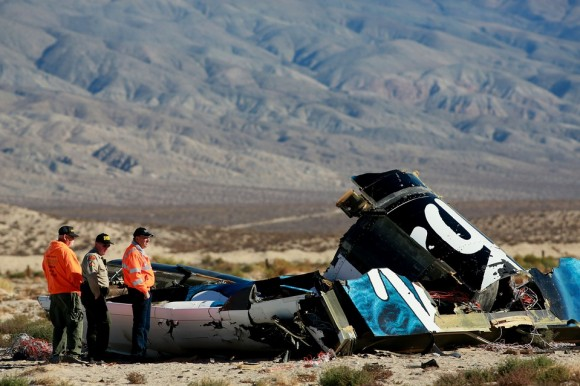 NTSB investigators are seen making their initial inspection of debris from the Virgin Galactic SpaceShipTwo. The debris field stresses over a fiver mile range in the Mojave desert. (Credit: Getty Images)