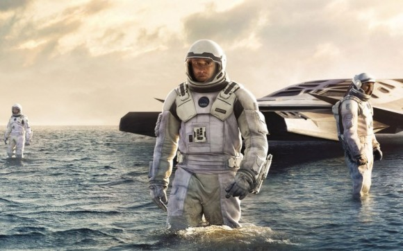 Mathew McConnaughey wades through an ocean on another planet. This is not a fishing expedition. He is out to save his children and all humanity. Image courtesy Paramount.