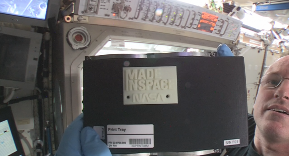 NASA astronaut Butch Wilmore (Expedition 42 commander on the International Space Station) holds the first 3-D printed part made in space, which was created on Nov. 25, 2014. Credit: NASA