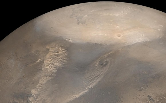 Early Spring Dust Storms at the North Pole of Mars. Early spring typically brings dust storms to northern polar Mars. As the north polar cap begins to thaw, the temperature difference between the cold frost region and recently thawed surface results in swirling winds. The choppy dust clouds of several dust storms are visible in this mosaic of images taken by the Mars Global Surveyor spacecraft in 2002. The white polar cap is frozen carbon dioxide. (NASA/JPL/Malin Space Science Systems)