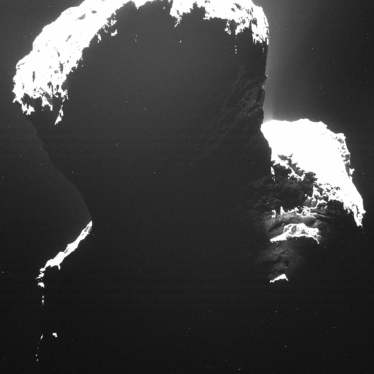"This ""dark side"" image of Comet 67P/Churyumov-Gerasimenko shows light backscattered from dust particles in the coma surrounding the comet, which helps scientists search for surface features. The picture was taken by the Rosetta spacecraft Sept. 29 from about 19 kilometers (12 miles). Credit: ESA/Rosetta/MPS for OSIRIS Team MPS/UPD/LAM/IAA/SSO/INTA/UPM/DASP/IDA"