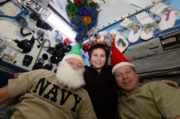 "ISS astronauts Barry ""Butch"" Wilmore, NASA, Samantha Cristoforetti, ESA and Terry Virts, NASA send Christmas 2014 greetings from the space station to the people of Earth. Credit: NASA/ESA"