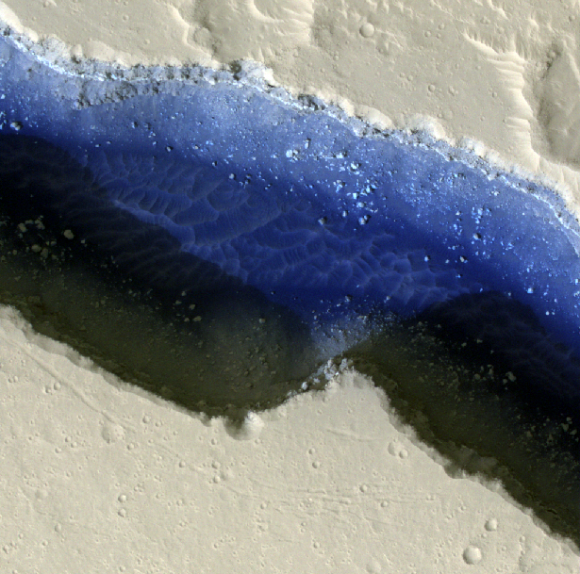 A false-color image of part of Cerberus Fossae on Mars. The view shows two rifts intersecting with each other, with sand (in deep blue) and dust. Credit: NASA/JPL-Caltech/University of Arizona/Western University Planetary Sciences Division