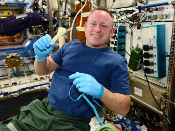 Expedition 42 commander Butch Wilmore holds up a 3-D-printed rachet, the first such tool made in space. Credit: NASA