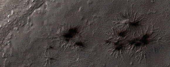 Carbon dioxide ice begins to feel the heat in the south pole region every spring. In this image of 'Inca City' taken in August 2014, you can see a few fans coming out from channels (araneiforms) that are created when pressurized gas escapes from the melting ice. Picture taken by the Mars Reconnaissance Orbiter's HiRISE camera. Credit: NASA/JPL/University of Arizona