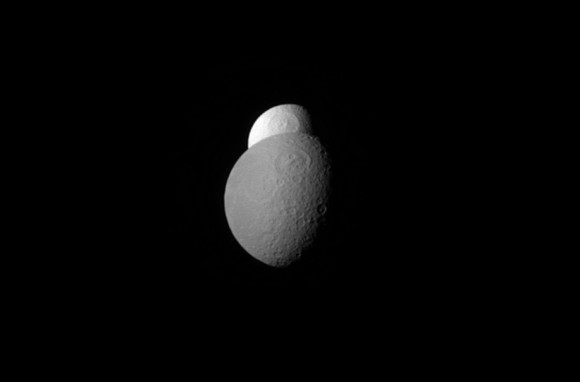 Tethys is mostly obscured behind Rhea as the moons orbit Saturn. The picture was captured by the Cassini spacecraft in April 2012 and highlighted in December 2014. Credit: NASA/JPL-Caltech/Space Science Institute