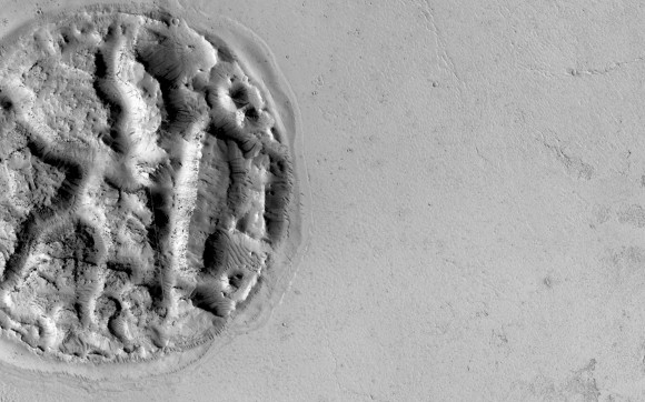 """The Mars Reconnaissance Orbiter took this image of a """"circular feature"""" estimated to be 1.2 miles (2 kilometers) in diameter. Picture released in December 2014. Credit: NASA/JPL-Caltech/University of Arizona"""