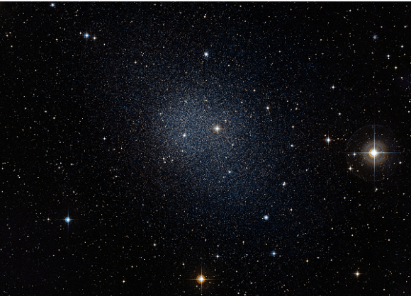 This dwarf spheroidal galaxy in the constellation Fornax is a satellite of our Milky Way and is one of 10 used in Fermi's dark matter search. The motions of the galaxy's stars indicate that it is embedded in a massive halo of matter that cannot be seen. Credit: ESO/Digital Sky Survey 2