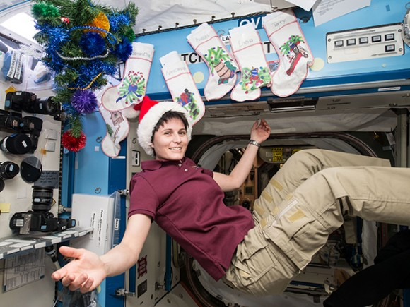 Italian astronaut Samantha Cristoforetti is in the holiday spirit as the station is decorated with stockings for each crew member and a tree. Credit: NASA/ESA