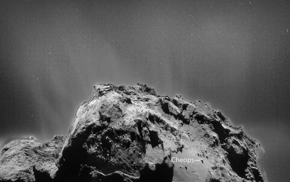Close-up of comet 67P showing the larger of the two lobes (boulder Cheops labelled), jets of dust and likely individual dust particles scattered around the comet. Credit: ESA/Rosetta/NAVCAM