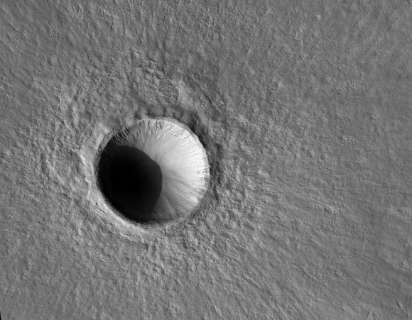 A fresh 1-km wide crater on Mars, captured by the HiRISE camera on the Mar Reconnaissance Orbiter. Or does it look like a mountain to you? Credit: NASA/JPL/University of Arizona.