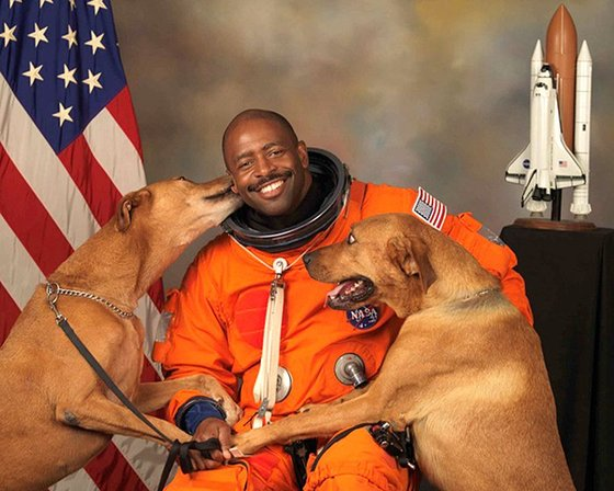 NASA astronaut Leland Melvin with his dogs Jake and Scout. Credit: NASA.