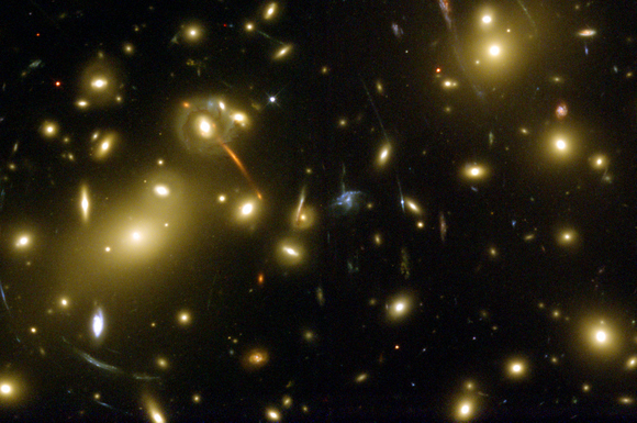The HST WFPC2 image of gravitational lensing in the galaxy cluster Abell 2218, indicating the presence of large amount of dark matter (credit Andrew Fruchter at STScI).