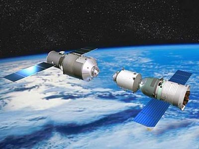 An artist's rendering of the Tiangong-1 module, China's space station, which was launched to space in September, 2011.  To the right is a Shenzhou spacecraft, preparing to dock with the module. Image Credit: CNSA