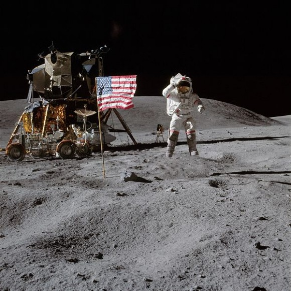 John Young - caught mid-leap - salutes the American flag on the lunar surface. Credit: NASA.