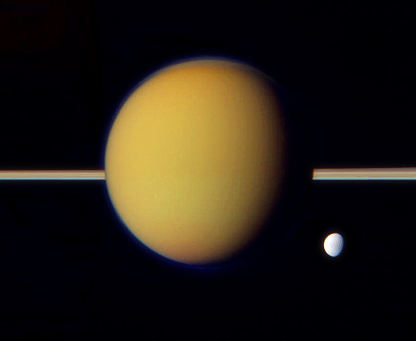 Titan's Gravity Indicates a Thicker, Uneven Icy Crust