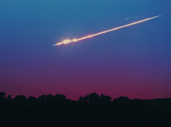 A bright fireball meteor in twilight. The Lyrids, like all meteor showers, offer up the occasional fireball among a mix of fainter meteors. Credit: John Chumack