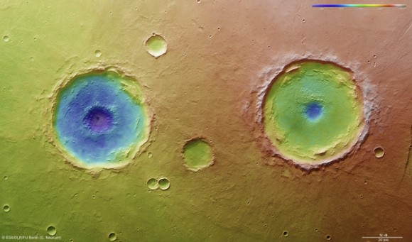 Arima twins topography. This colour-coded overhead view is based on an ESA Mars Express High-Resolution Stereo Camera digital terrain model of the Thaumasia Planum region on Mars at approximately 17°S / 296°E. The image was taken during orbit 11467 on 4 January 2013. The colour coding reveals the relative depth of the craters, in particular the depths of their central pits, with the left-hand crater penetrating deeper than the right (Arima crater).  Copyright: ESA/DLR/FU-Berlin-G.Neukum